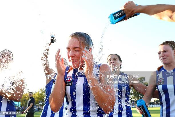 Mia King of the Kangaroos sings the song and celebrates victory with team mates during the round four AFLW match between the North Melbourne...