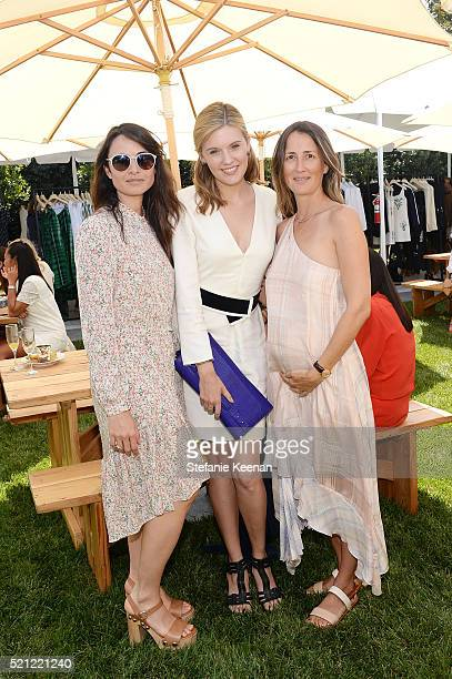 Mia Maestro Maggie Grace and Anna Getty attend Annual HEART Brunch Featuring Stella McCartney on April 14 2016 in Los Angeles California