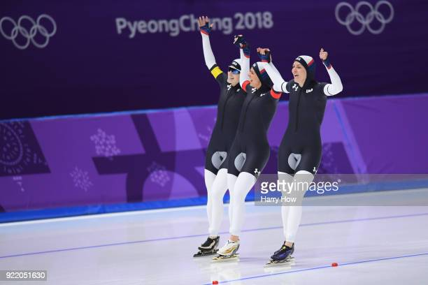 Mia Manganello Brittany Bowe and Heather Bergsma of the United States celebrate after winning the bronze medal during the Speed Skating Ladies' Team...