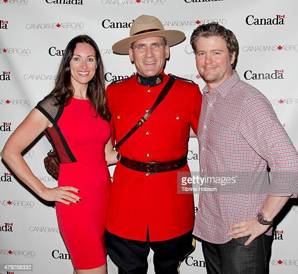Mia Mastroianni Corporal Jeff Peters and David J Phillips attend the Canada Day in LA party at on July 1 2015 in Santa Monica California