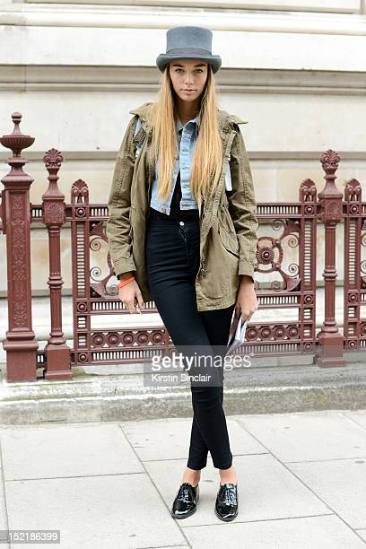 Mia Matic, model wearing American Appareil shoes, leggings, bag, and denim jacket, zara t shirt and Army jacket, Hat from Jam shop on day 3 of London...
