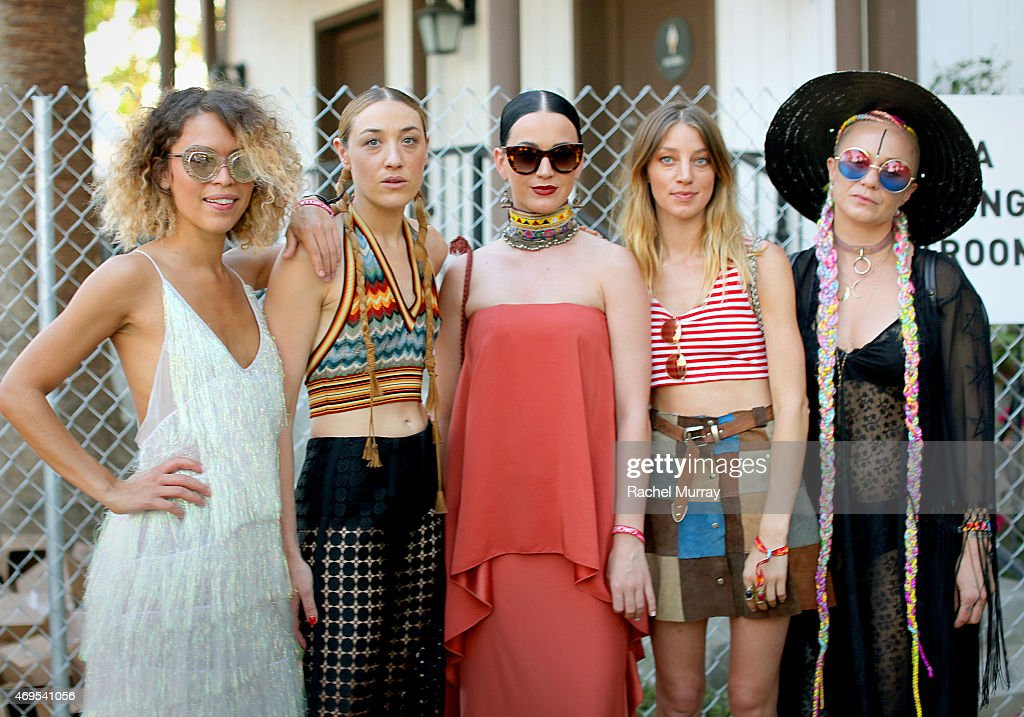 Mia Moretti (2ndL) and Katy Perry (C) with guests in the VIP arena during the 2015 Coachella Valley Music and Arts Festival - Weekend 1 at The Empire Polo Club on April 12, 2015 in Indio, California.