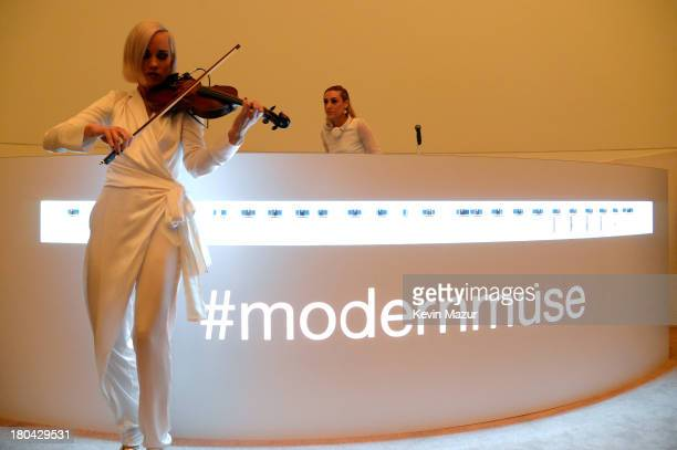 Mia Moretti and Margot of The Dolls perform at the Estee Lauder Modern Muse Fragrance Launch Party at the Guggenheim Museum on September 12 2013 in...