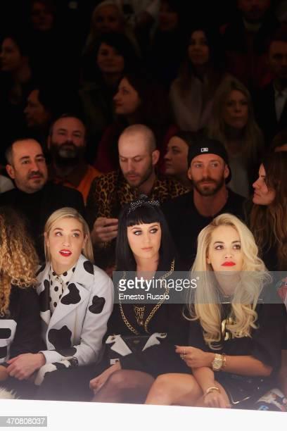 Mia Moretti Katy Perry and Rita Ora attend the Moschino fashion show during Milan Fashion Week Womenswear Autumn/Winter 2014 on February 20 2014 in...