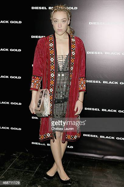 Mia Moretti poses backstage at the Diesel Black Gold fashion show during MercedesBenz Fashion Week Fall 2014 at Skylight at Moynihan Station on...