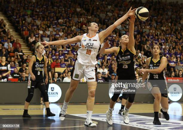 Mia Murray of the Townsville Fireis challenged by Maddie Garrick of the Melbourne Boomers during game two of the WNBL Grand Final series between the...