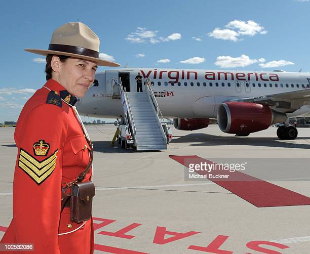 Mia Poscente of the Royal Canadian Mounted Police stands gaurd in front of 'Air Drake' to celebrate Virgin America's first international flight to...