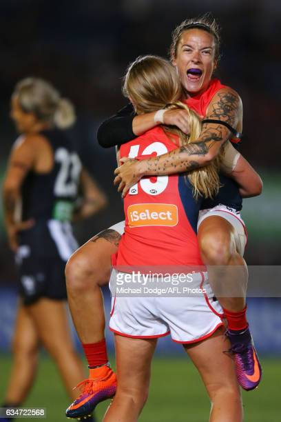 Mia RaeClifford of the Demons jumps on Katherine Smith after winning the round two AFL Women's match between the Collingwood Magpies and the...