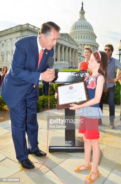 Mia Robertson¨ receives a Certificate of Special Congressional Recognition from Rep Trent Franks during a press conference to Raise Awareness For...