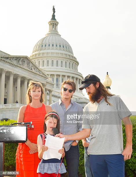 Mia Robertson with her parents Missy Robertson and Jase Robertson from the 'Duck Dynasty' television show speaks during a press conference to Raise...