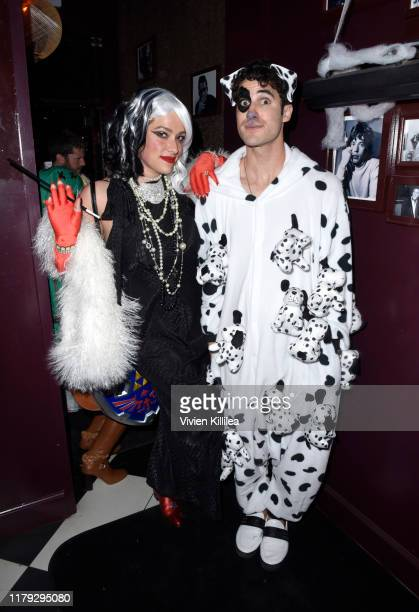 Mia Swier and Darren Criss attend Podwall Entertainment's 10th Annual Halloween Party presented by Maker's Mark on October 31 2019 in West Hollywood...