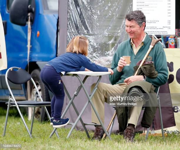 Mia Tindall and her step-grandfather Vice Admiral Sir Timothy Laurence attend the Whatley Manor Horse Trials at Gatcombe Park on September 8, 2018 in...