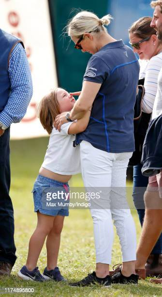 Mia Tindall and Zara Tindall queue to buy an ice cream as they attend day 3 of the Whatley Manor Gatcombe International Horse Trials at Gatcombe Park...
