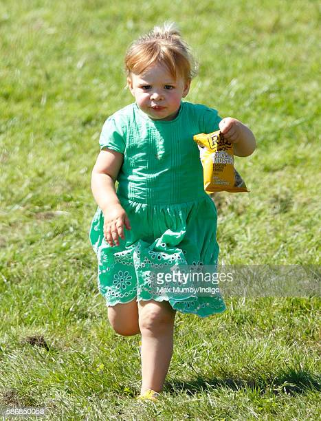 Mia Tindall carries a bag of crisps as she attends day 2 of the Festival of British Eventing at Gatcombe Park on August 6 2016 in Stroud England