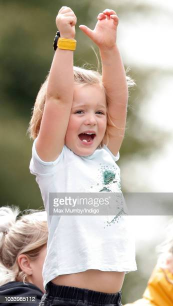Mia Tindall cheers on her mother Zara Tindall as she tackles the water jump during the cross country phase of the Whatley Manor Horse Trials at...