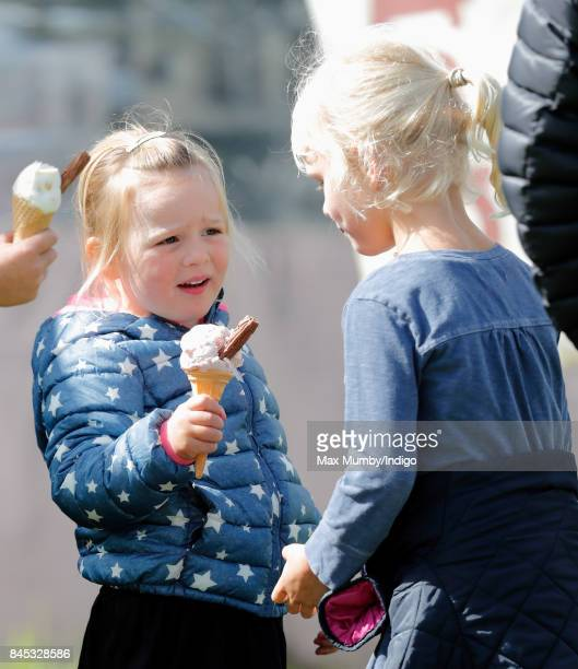 Mia Tindall eats an ice cream as she and cousin Isla Phillips attend the Whatley Manor Horse Trials at Gatcombe Park on September 9 2017 in Stroud...
