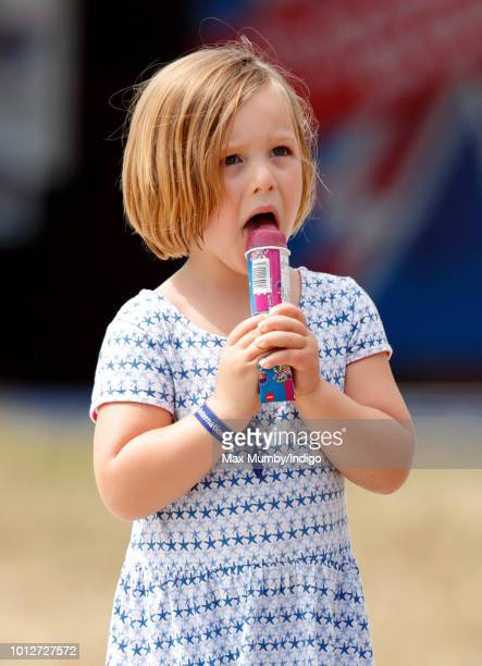 Mia Tindall eats an ice lolly as she attends day 1 of The Festival of British Eventing at Gatcombe Park on August 3 2018 in Stroud England