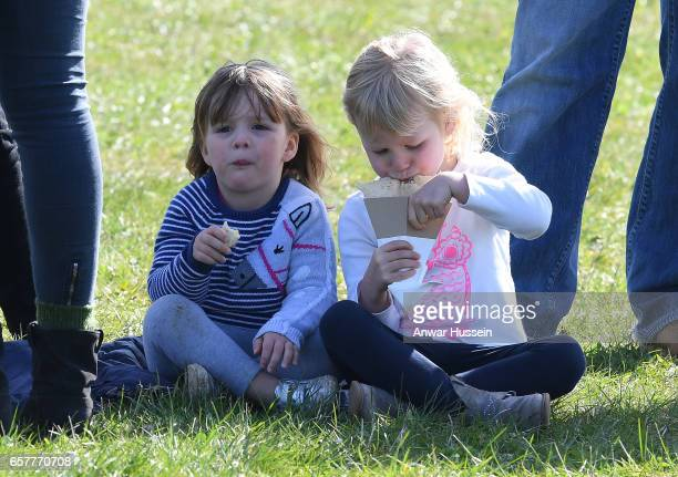 Mia Tindall enjoys a snack with her cousin Isla Phillips during the Gatcombe Horse Trials at Gatcombe Park on March 25 2017 in Stroud England