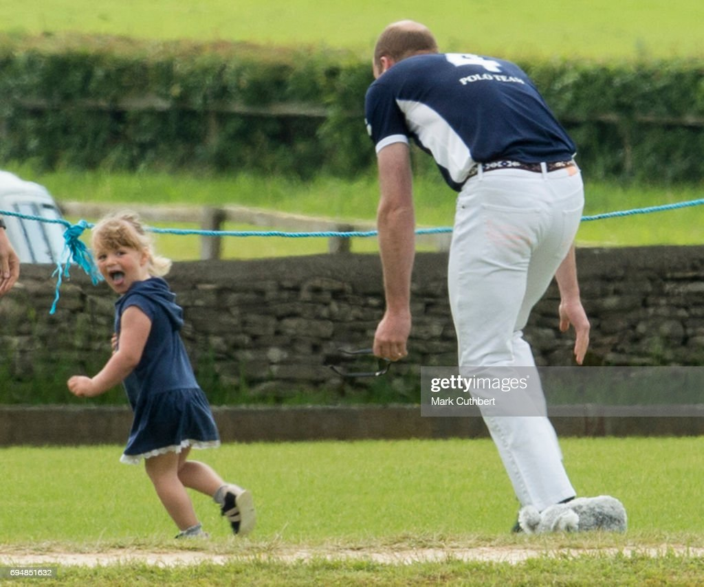 Mia Tindall gets playfully chased by Prince William, Duke of Cambridge at The Maserati Royal Polo Trophy match during The Gloucestershire Festival of Polo at Beaufort Polo Club on June 11, 2017 in Tetbury, England.