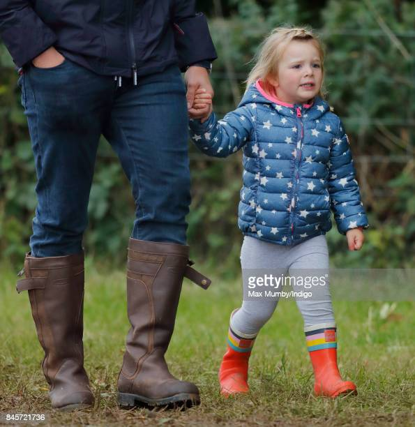 Mia Tindall holds hands with her father Mike Tindall as they attend day 3 of the Whatley Manor Horse Trials at Gatcombe Park on September 10 2017 in...