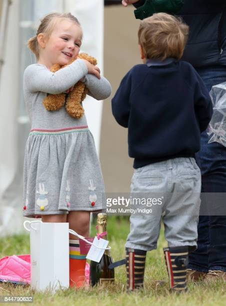 Mia Tindall hugs a teddy bear as she attends the Whatley Manor Horse Trials at Gatcombe Park on September 8 2017 in Stroud England