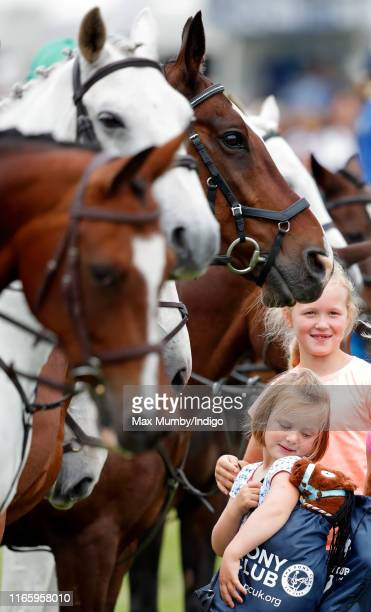 Mia Tindall looks over her shoulder at her soft toy horse as she attends day 2 of the 2019 Festival of British Eventing at Gatcombe Park on August 3,...