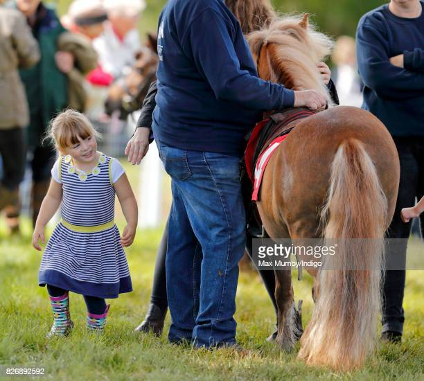 Mia Tindall meets a Shetland Pony as she attends day 2 of the Festival of British Eventing at Gatcombe Park on August 5 2017 in Stroud England