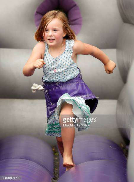 Mia Tindall plays on a bouncy castle as she attends day 1 of the 2019 Festival of British Eventing at Gatcombe Park on August 2, 2019 in Stroud,...