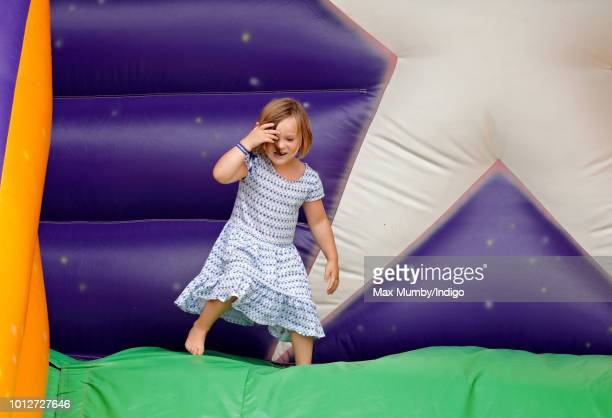 Mia Tindall plays on an inflatable bouncy slide as she attends day 1 of The Festival of British Eventing at Gatcombe Park on August 3 2018 in Stroud...