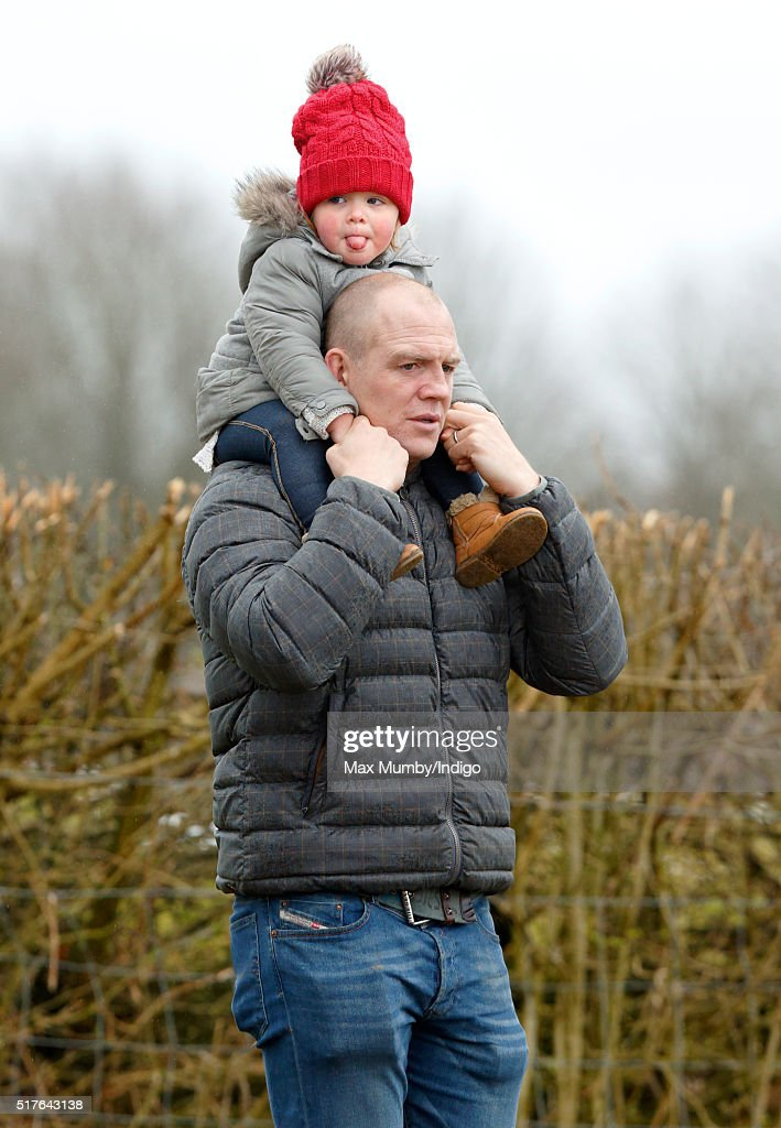 Mia Tindall pokes out her tongue as she rides on her father Mike Tindall's shoulders as they attend the Gatcombe Horse Trails at Gatcombe Park, Minchinhampton on March 26, 2016 in Stroud, England.