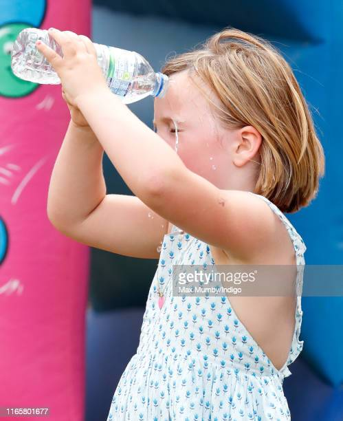 Mia Tindall pours a bottle of water over her head as she attends day 1 of the 2019 Festival of British Eventing at Gatcombe Park on August 2, 2019 in...