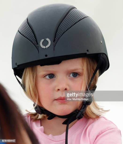Mia Tindall rides on a horse riding simulator as she attends day 1 of the Festival of British Eventing at Gatcombe Park on August 4 2017 in Stroud...