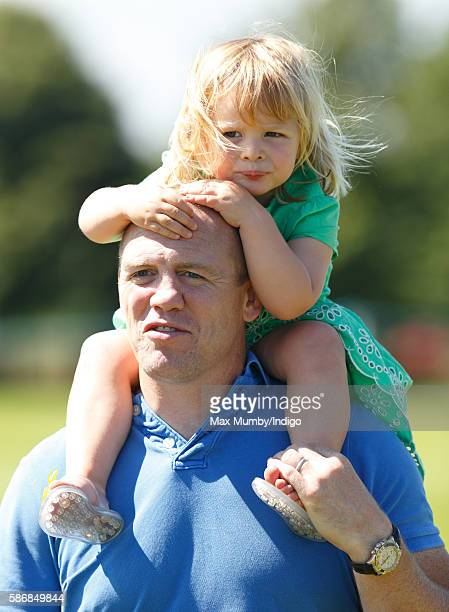 Mia Tindall rides on her father Mike Tindall's shoulders as they attend day 2 of the Festival of British Eventing at Gatcombe Park on August 6 2016...