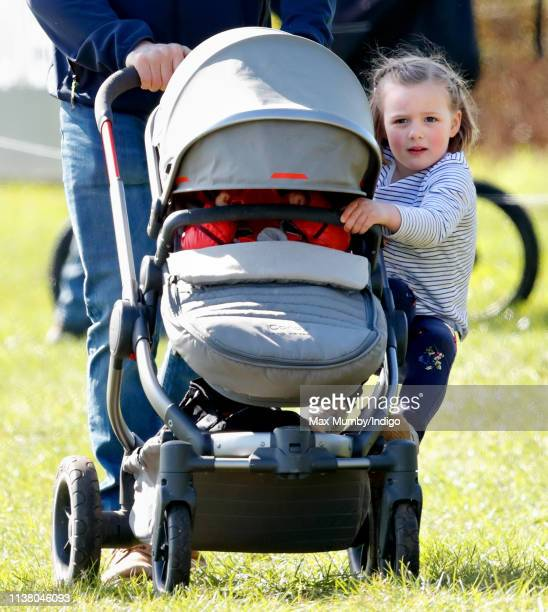 Mia Tindall rides on sister Lena Tindall's pushchair as she attends the Gatcombe Horse Trials at Gatcombe Park on March 24 2019 in Stroud England