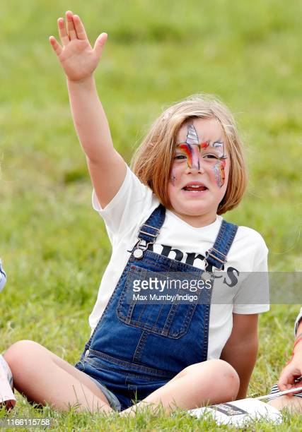 Mia Tindall, seen wearing face paint, watches a falconry demonstration as she attends day 3 of the 2019 Festival of British Eventing at Gatcombe Park...