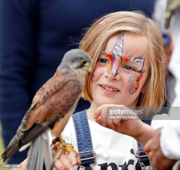 Mia Tindall, seen with her face painted, holds a kestrel after watching a falconry demonstration on day 3 of the 2019 Festival of British Eventing at...