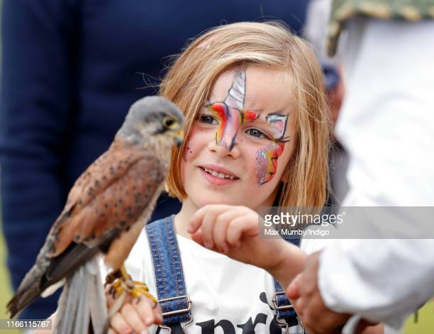 Mia Tindall seen with her face painted holds a kestrel after watching a falconry demonstration on day 3 of the 2019 Festival of British Eventing at...