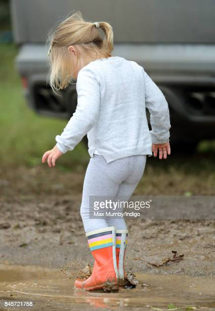 Mia Tindall splashes in a muddy puddle as she attends day 3 of the Whatley Manor Horse Trials at Gatcombe Park on September 10 2017 in Stroud England