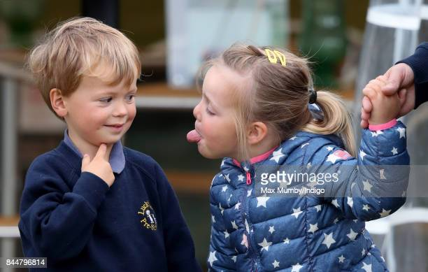 Mia Tindall sticks her tongue out at Charlie Meade as they attend the Whatley Manor Horse Trials at Gatcombe Park on September 8 2017 in Stroud...