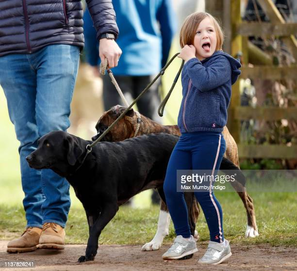 Mia Tindall walks her dog as she attends the Gatcombe Horse Trials at Gatcombe Park on March 23, 2019 in Stroud, England.