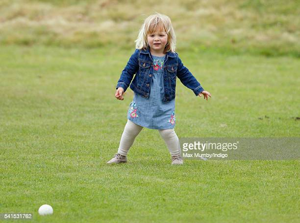 Mia Tindall watches her mother Zara Phillips play in a Jockeys vs Olympians charity polo match at the Beaufort Polo Club on June 19 2016 in Tetbury...
