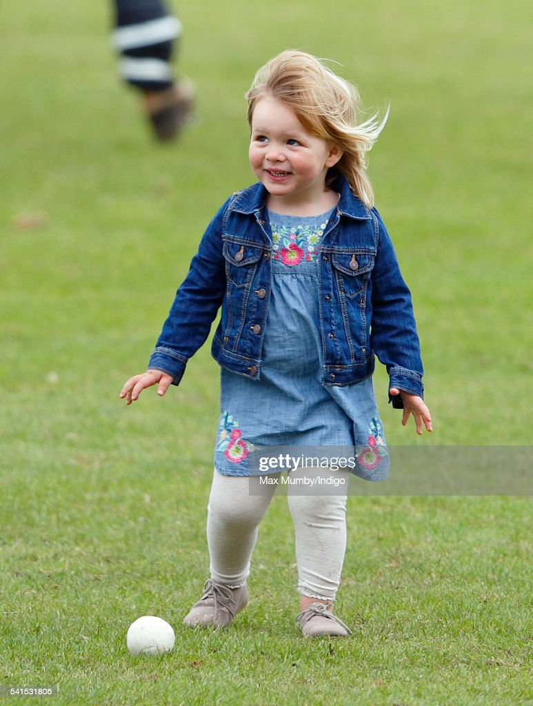 Mia Tindall watches her mother Zara Phillips play in a Jockeys vs Olympians charity polo match at the Beaufort Polo Club on June 19, 2016 in Tetbury, England.