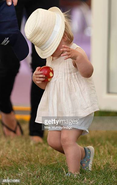 Mia Tindall's hat falls over her face as she attends day 2 of the Festival of British Eventing at Gatcombe Park on August 8 2015 in Stroud England