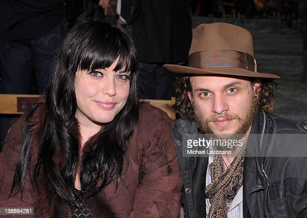 Mia Tyler and Jesse Kotansky attend the Tommy Hilfiger Fall 2012 fashion show during MercedesBenz Fashion Week at Park Avenue Armory on February 12...