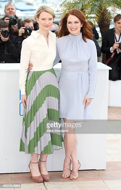 Mia Wasikowska and Julianne Moore attend the 'Maps To The Stars' photocall at the 67th Annual Cannes Film Festival on May 19 2014 in Cannes France