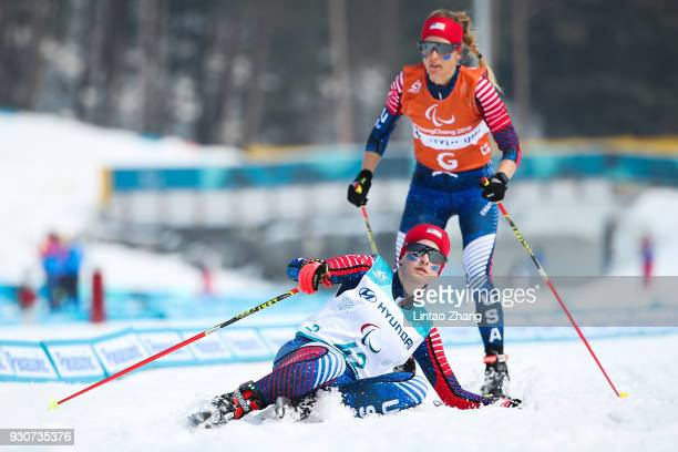 Mia Zutter of the United States is fall down with her guide Kristina TrygstadSaari competes in the Women's 15km Free Visually Impaired Cross Country...