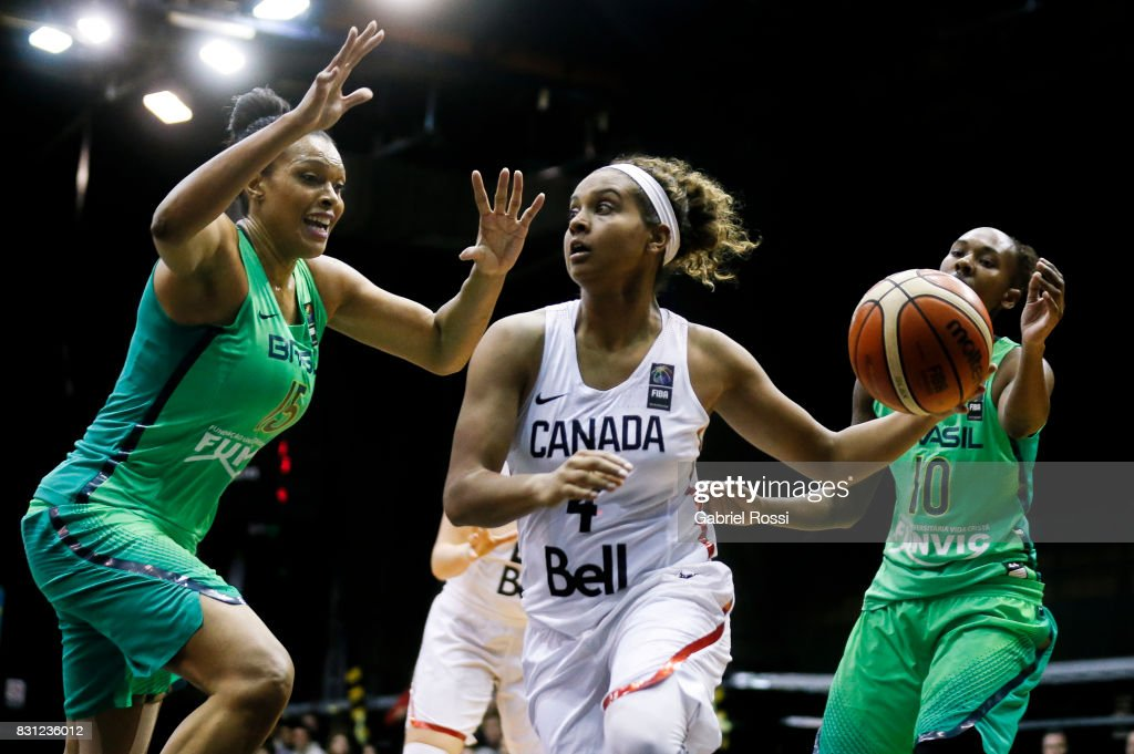 Miah-Marie Langlois of Canada (C) fights for the ball with Kelly Santos of Brazil (L) during a match between Canada and Brazil as part of the FIBA Women's AmeriCup Semi Final at Obras Sanitarias Stadium on August 12, 2017 in Buenos Aires, Argentina.