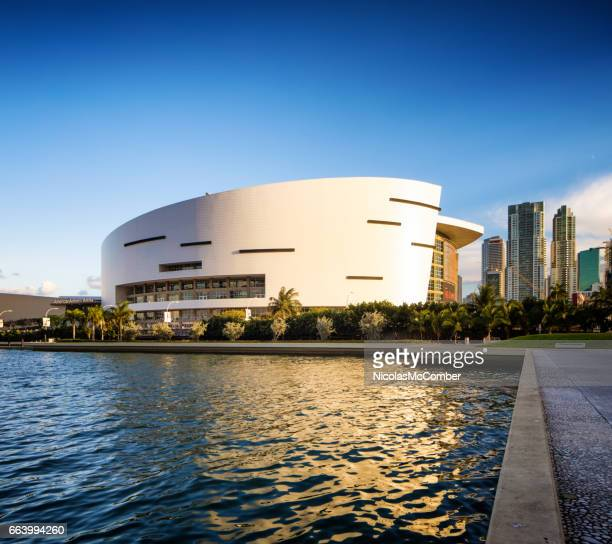 Miami American Airlines stadium side view with canal and reflection at sunset