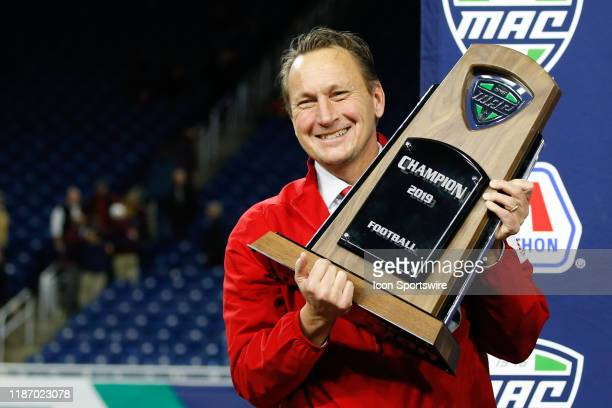 Miami Athletic Director David Slayer holds the championship trophy during the post-game awards ceremony following the Mid-American Conference...