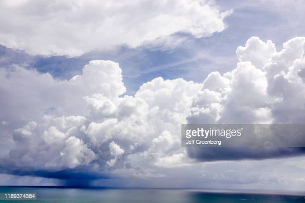 Miami Beach, approaching storm over ocean.